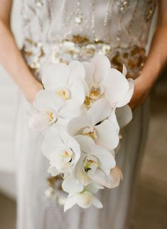 Orchid Wedding Bouquets in Brilliant Colors - via Colin Cowie Weddings bouquets orchids Orchid Wedding Bouquets in Brilliant Colors - MODwedding White Orchid Bouquet, Orchid Bridal Bouquets, White Wedding Bouquets, White Orchids, Bride Bouquets, Bridal Flowers, Flower Bouquet Wedding, Bridesmaid Bouquet, Floral Wedding