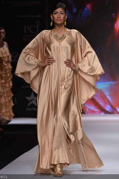 Carol Gracias walks the ramp to showcase a creation by jewellery designer group Kays Jewels during the International Jewellery Week (IIJW) in Delhi on April 13, 2013