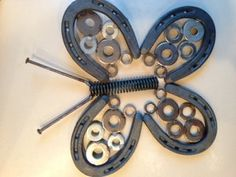 Horse shoe Butterflies #DIY #crafts i wanna make these on rods to stick in my flower beds this spring!