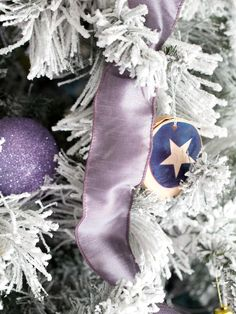 To ensure that colors coordinate without becoming matchy-matchy, choose tints and shades of the dominant color that have grey undertones. The glass ornaments, silk ribbon garland and graphic cutouts all feature medium shades of lavender. This results in a more understated, wintry approach to purple rather than a rich, royal vibe.