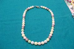 Multi coloured pearl necklace and silver clasp - A$20.00