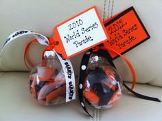 2010 and 2012 World Series Parade Christmas ornaments with ticker tape from parade. San Francisco Giants
