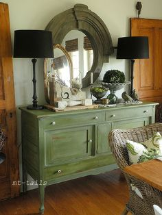 vintage dining room with green milk paint buffet, black lamps. spring 2013