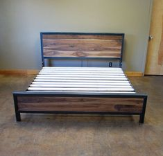 The king size version of the Kraftig series with walnut. The frame is 2x3 steel tube. The head and footboards have 1 walnut boards which have been planed, sanded and sealed. When ordering please indicate which king size; California or Eastern You may use this bed with or w/o a box spring. This version is for use w/o a box spring. Dimensions for version shown: Headboard Height: 44 Footboard Height: 19 Footboard Clearance: 6 Side Rail Clearance: 10 By making the rails higher tha...