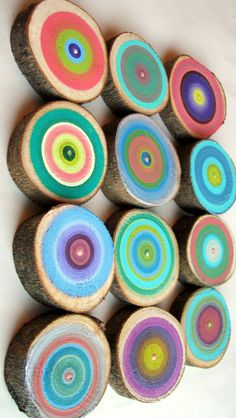 Wall Art: 12 Tree Rings Handpainted -Colourful Abstract -via Heather Montgomery. (To hang: drill hole in back of each trunk for nail)
