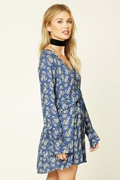 Forever 21 Contemporary - A woven swing dress featuring an allover floral print, V-neckline, long raglan sleeves, ruffle trim, and a mock button front.
