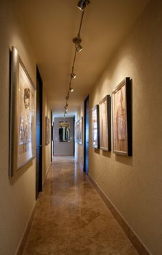 Lighting - art spotlighted    Art Gallery Hallway - Dale Hanson Photography - contemporary - hall - other metro - Peg Berens Interior Design LLC