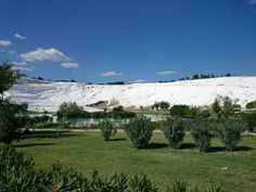 View to snow white slopes of #Pamukkale over the lake
