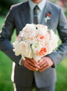 Love this bouquet & the idea of having the groom hold the bouquet for a pic.
