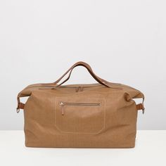 Waxed canvas travel bag in brown | Ally Capellino | Ally Capellino