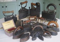 A wonderful collection of old irons - flat irons, sad irons, patent irons, Mrs Potts irons and more - unique collection and each iron very decorative - they make good door stops and book ends as well!