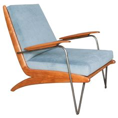 French Mid-Century Steel and Walnut Lounge Chair | From a unique collection of antique and modern chairs at https://www.1stdibs.com/furniture/seating/chairs/