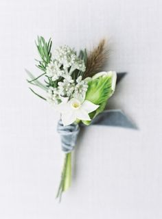 Ice blue, cool grey & white winter buttonholes  Photography: www.sarahhannam.com