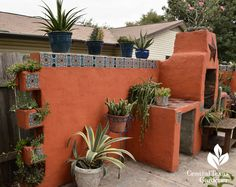 cinder block stucco wall containers Central Texas Gardener