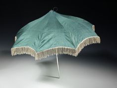 Parasol, silk trimmed with fringe, silver, steel and morocco leather, 1810-11, probably made in London, England.