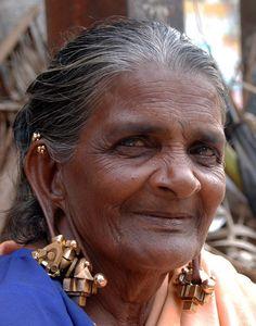 India | Tamil Nadu woman wearing Pampadam earrings. Kanyakumari District | ©Aneez Ahmed