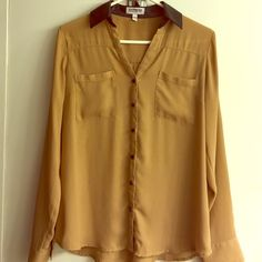 Ladies express Blouse Portofino shirt Ladies Blouse size small from express. Tan color.  Collar and buttons are black. Collar is faux Leather. This is the Part of the Portofino collection from express. Worn few times, great condition. Great work blouse Express Tops Blouses