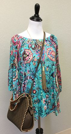 So so pretty in turquoise, this floral print sure doesn't disappoint!  Our customers LOVE this style and cute fit -- perfect with capris, leggings or denim!  ***SHOWN WITH OUR BRIELLE NECKLACE & OUR MINI GEORGIE CROSS BODY!! SO CUTE! ***
