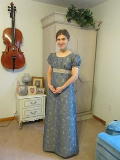 THIS DRESS CAN BE MADE TO ORDER This is a(new,never worn,only modeled) lovely Jane Austen /Regency style dress in a slate blue with taupe leaf pattern
