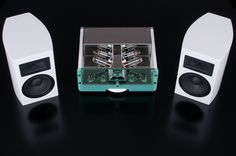 White elegant style of our amplifier with small monitor speakers