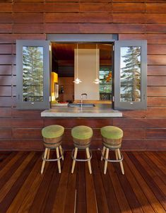 The window also acts as a serving station and bar area, allowing guests on the large ipe wood deck to engage with those in the kitchen.