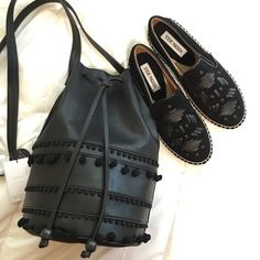 NWT LEATHER BUCKET BAG New with tags 100% vegan leather crossbody bucket bag with pompom details. Super cute perfect for music festivals  Grace Roberts Bags Crossbody Bags