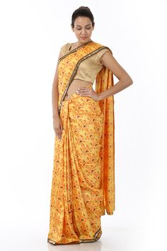 A fashionably designed yellow kosa silk sari, rendered with a heavy dose of floral highlights this piece is sure to win accolades. It is accentuated with a contrasting border and comes with a complimenting blouse piece.