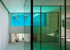 Wiel Arets' Jellyfish House has an elevated pool with a glass floor