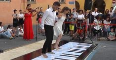 Two dancers step on a huge piano, and leave the audience speechless when they start to move