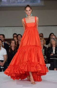 Featured: Oscar de la Renta Tiered Gown Among the occasion gowns, a tiered empire-waisted number is always a standout with its elegant double-ruffled flounce. In coral silk taffeta, it's unmistakab…