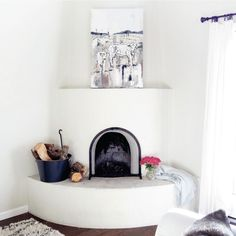 Love this white adobe fireplace eclecticallyvintage.com