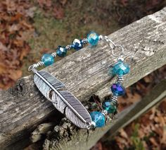 Pewter Feather Crystal Boho Bracelet in shades of blue  on Etsy, $18.99