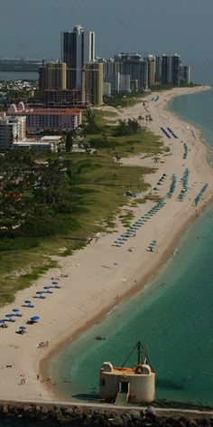 Singer Island features mile after mile of pristine white sand beaches sure to…