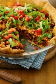 Easy dinner bake with quick crescent crust, ground beef, cheese, and taco toppings!
