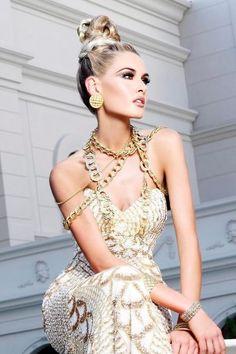 "Miss Ohio USA 2012, Audrey Bolte, poses for fashion photographer Fadil Berisha at the ""Gardens of Goddess"" photo shoot at Caesar's Palace Las Vegas Hotel & Casino pool"