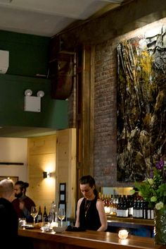 The bar with its framed cluster of birch trunks. (Photo: Christian Hansen for The New York Times)