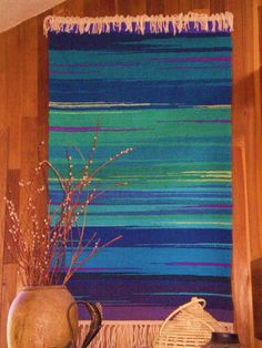 """""""Imago"""" ... All pieces are handwoven in the Rio Grande Tradition (Hispanic) with 100% hand-dyed wool on a large floor walking loom.  This style of weaving was brought to the Southwest by Spanish settlers in the 16th century and is traditional to the people of the middle and upper Rio Grande valleys in New Mexico and Southern Colorado, where I make my home.  This style actually derives from the interweaving of the Spanish, Mexican native, and the local Indian pueblo weaving cultures."""