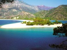 Olu Deniz (Dead Sea) near Fethiye - Turkey, a serene lagoon beach with turquoise waters . Best Beaches To Visit, Cool Places To Visit, Places To Travel, Most Beautiful Beaches, Beautiful Places, Beautiful Scenery, Beautiful Sunset, Places Around The World, Around The Worlds