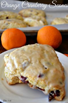 These Orange Cranberry Scones are one of my favorite things to eat with my coffee.  They are full of orange flavor in each bite.  They make a great dessert too.  After one bite of these Orange Cranberry Scones, I was doing a happy dance.   http://www.recipesforourdailybread.com/orange-cranberry-scones/   #scones #breakfast #orangescones