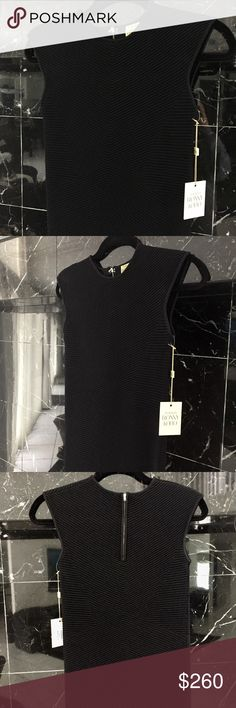 "Torn by Ronny Kobo ""Kikimora"" Dress Torn by Ronny Kobo ""Kikimora"" Dress NWT Never worn. Brand new condition  Ribbed panels refine the silhouette of a formfitting Ronny Kobo dress. Sleeveless. Covered zip closure. Unlined.  Fabric: Mid-weight ribbed knit. 74% rayon/24% nylon/2% spandex. COLOR: Black  Measurements based off model in Red Length: 34.25in / 87cm, from shoulder Measurements from size S   As seen SOLD OUT on Shopbop in red Torn by Ronny Kobo Dresses Midi"