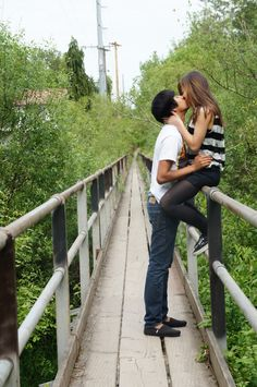 """Kiss on a bridge - engagement photo idea... Must do when you guys come up for your """"Save the dates"""" :)"""