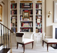 Built-in moulded bookcases with lights over them! A fabulous white chair with leather trim! LOVE IT!