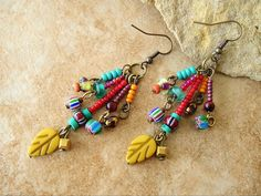These playful earrings are perfect for Boho sweater weather. I combined five separate, colorful beaded dangles together, onto a brass ring. Each