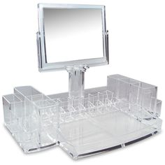 Find your lipstick, foundation, lotions and potions with just a quick glance when you bring this clear acrylic cosmetic organizer into your home. Compartments in a multitude of shapes and sizes make i
