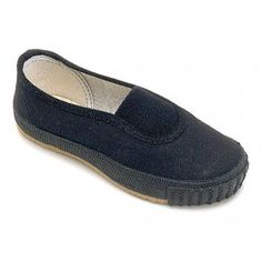 Black Plimsolls for PE. These were out indoor shoes at school. Had to change in to them as soon as we got in the class room