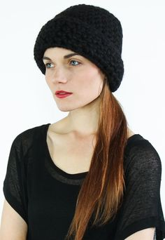This chunky military inspired toque is made from a soft alpaca wool blend. UnisexFiber: All our alpaca yarns are Fair-trade sourced from Peru. 80% alpaca 20% woolCare: Hand wash or Dry clean. Wash in tepid water with a mild soap. Do not twist. Shape and dry flat on a towel.All pieces are knit to order. Please allow 1-2 weeks.All designs