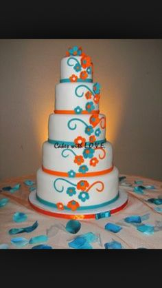 Turquoise and tangerine wedding cake