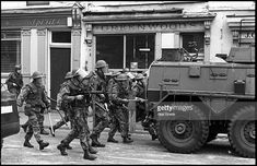 6cfd2778e7 British soldiers in riot gear move down Springfield Road onto the  republican Falls Road in Belfast