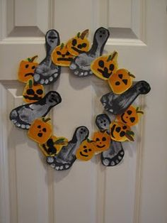 Tutorial for creating a hand and footprint Halloween-themed wreath with kids.