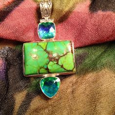 Pendant.  Price Firm!! Stunning sterling silver green turquoise and gemstone pendant. Jewelry Necklaces